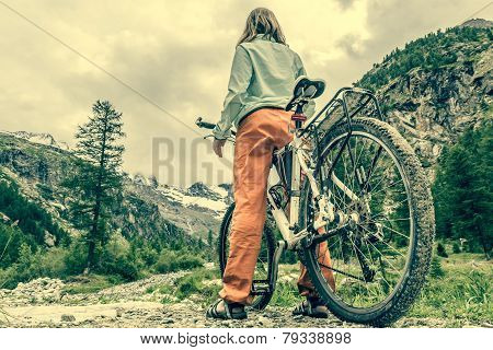 Cyclist Having A Rest On Her Trip