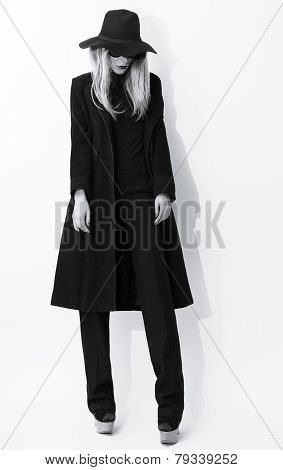 Fashion Black And White Photo. Glamorous Blonde In Classic Coat And Hat