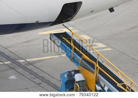 Conveyor for an aircraft