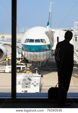 Silhouette Of A Businessman Waiting For Boarding In An Airport