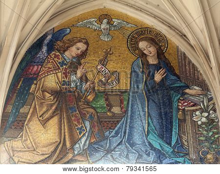 VIENNA, AUSTRIA - OCTOBER 10: Mosaic of Annunciation from main portal of gothic church Maria am Gestade on October 10, 2014 Vienna.
