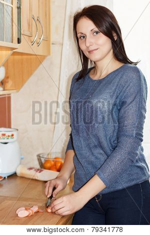 Food Preparation - Woman Cutting Sausage
