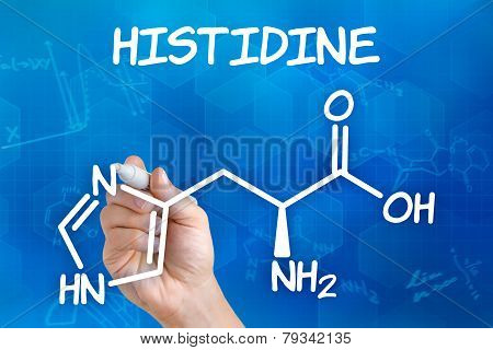 Hand with pen drawing the chemical formula of histidine