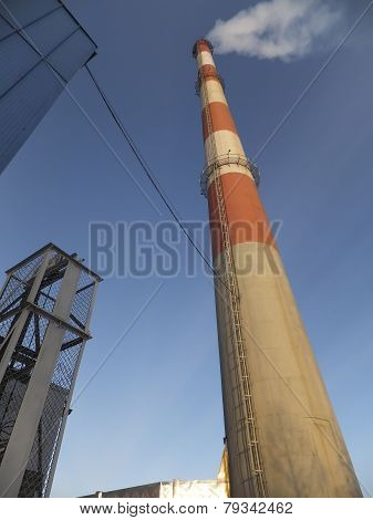 White And Red High Concrete Chimney