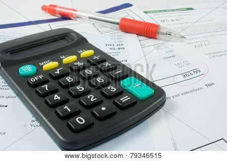 Calculator,pen, and Bills