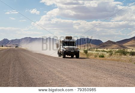 Driving In A Dirt Road