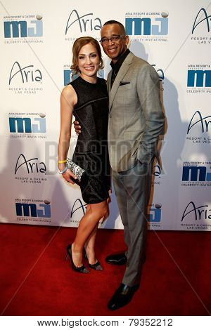 LAS VEGAS-APR 4: ESPN sportscaster Stuart Scott (R) and Kristin Spodobalski attend the 13th annual Michael Jordan Celebrity Invitational gala at the ARIA Resort & Casino on April 4, 2014 in Las Vegas.