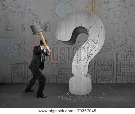 Businessman Holding Hammer Cracked Question Mark With Business Concept Doodles