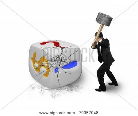 Businessman Holding Sledgehammer Hitting Large Dice With Dollar Sign
