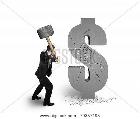 Businessman Holding Hammer Hitting Cracked Dollar Sign Isolated On White