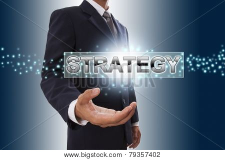 Businessman hand showing strategy button.