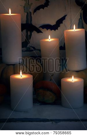 Halloween composition on board on old wooden wall background