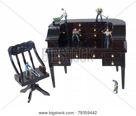 Workers Using Teamwork And Tools On A Desk