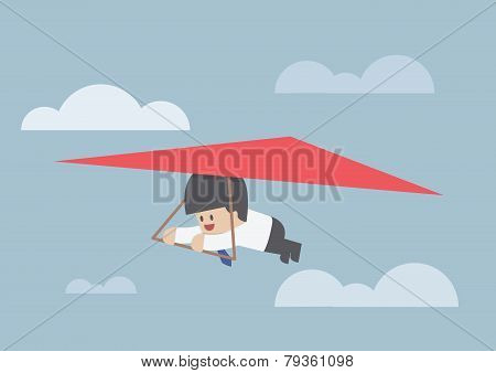 Businessman Riding A Hang Glider