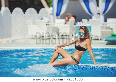 Sexy beautiful woman in the pool.