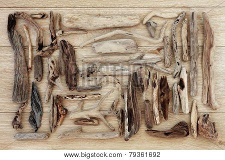 Driftwood selection over old oak wood background.