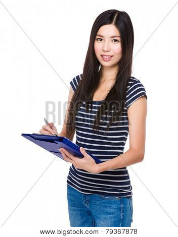Woman jot down some note on file pad