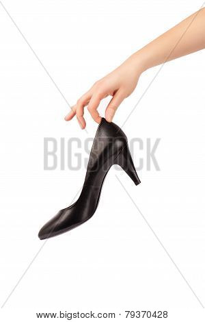 Woman female hand holding shoe isolated on white with clipping path
