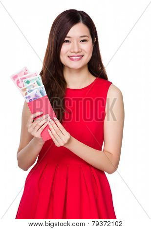 Asian woman hold red pocket money with RMB