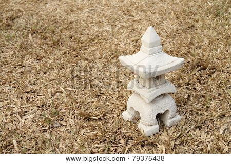 Sculptuer Of House With A Chinese Style Roof On Dry Turf
