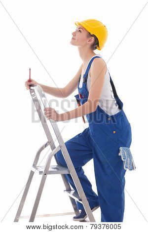 Young Woman Builder In Blue Coveralls With Screwdriver On Ladder Isolated On White