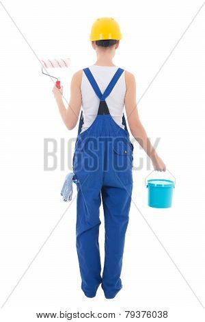 Back View Of Young Woman Painter In Blue Coveralls With Builder's Tools Isolated On White