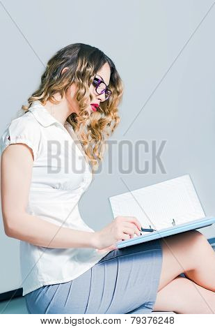 Beautiful Young Business Woman Working With Documents