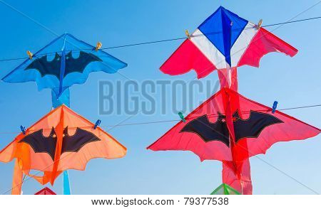 Thailand flag color kite and bat kites hanging on string