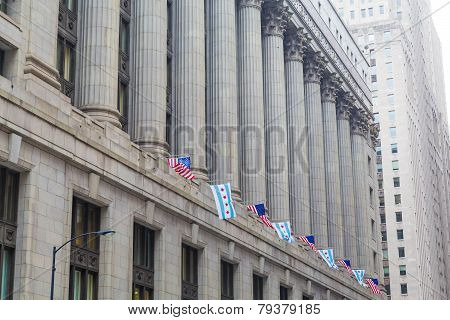 American Flags Under Stone Columns