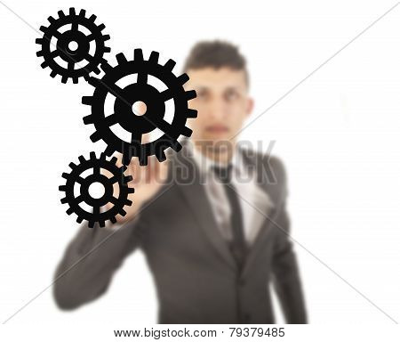 Young Businessman With Black Gears Isolated On White Background