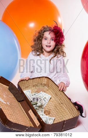Surprised Girl With A Suitcase, In Which Lie The Dollar Amid Large Balloons