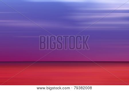 Blurred Red And Blue Sea Horizon