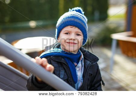 Little Boy In Pompon Cap At Winter