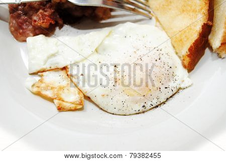 A Peppered Over Easy Fried Egg