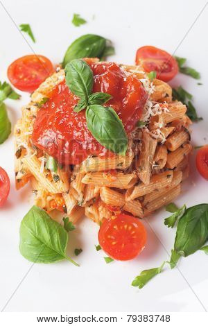 Pasta milanese, penne rigate with parmesan cheese, tomato sauce and basil