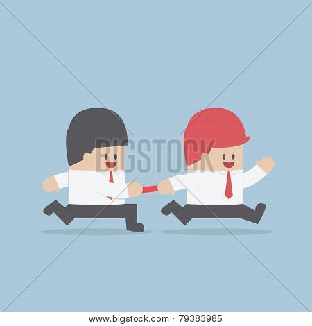 Businessman Passing Baton To The Other In Relay Race