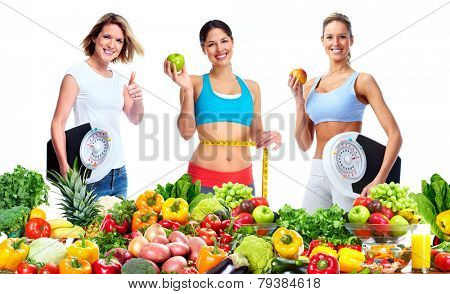 Woman with scales fruits and vegetables background