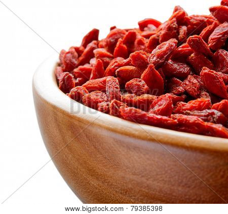 Wooden Bowl Full of Dried Goji Berries on the White Table. Healthy Diet