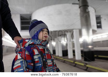 Mother Holding Son On Subway Platform
