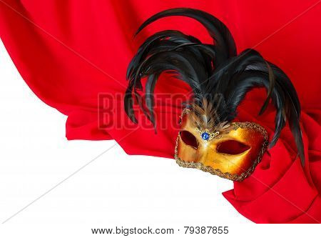 Venetian mask on red fabric