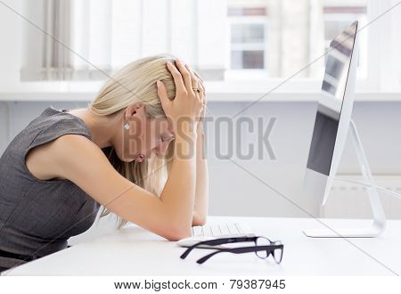 Overworked woman in front of computer