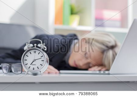 Exhausted woman sleeping in office