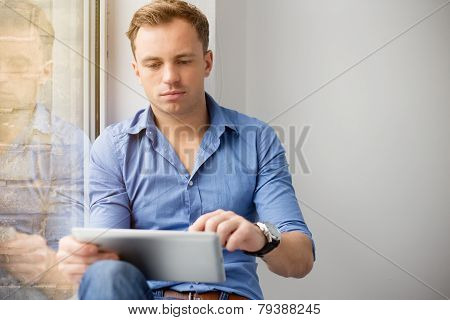 Young creative man using tablet computer