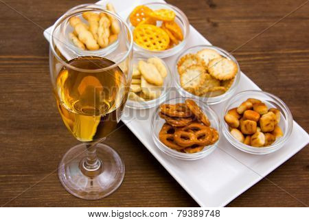 Flute with aperitif and pretzels