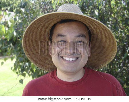 Asian Man Wearing Straw Hat