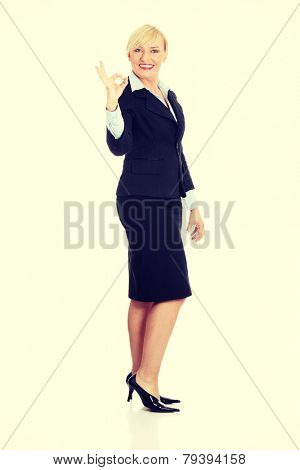 Mature business woman's gesticulating perfect