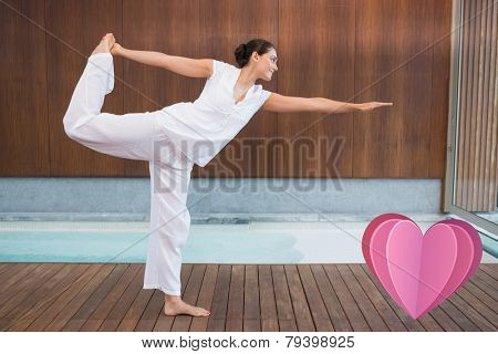 Content brunette in white in the shiva posture against heart