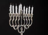 image of menorah  - Extinct candles on the menorah - JPG