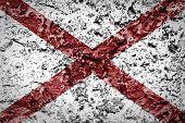 stock photo of alabama  - Alabama State Flag painted on grunge wall - JPG