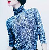 stock photo of green snake  - Sensual brunette model in fashionable blouse with snake print on white background - JPG